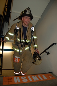 Firefighter at finish line, Climb to the Top Boston 2016